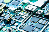 Electronic boards close-up with chips and electronic components, abstract