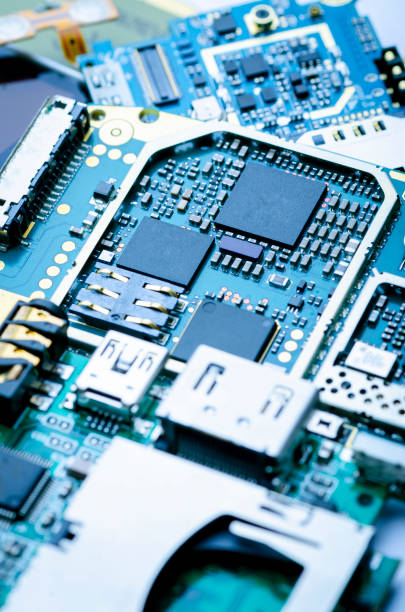 Electronic boards with chips, electronic components and precious metals close-up