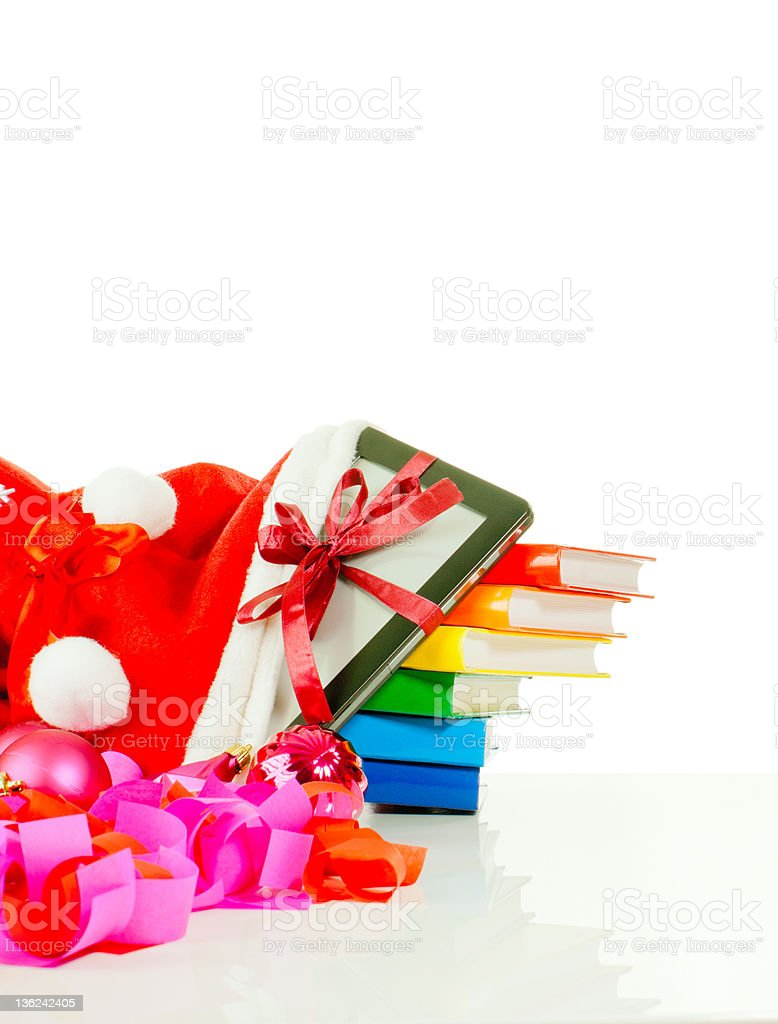 Electronic book reader with stack of books in bag stock photo