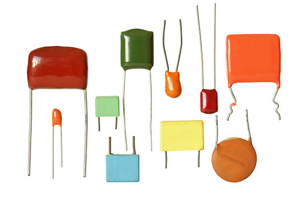 electronic capacitors several types isolated on white background - capacitor stock photos and pictures