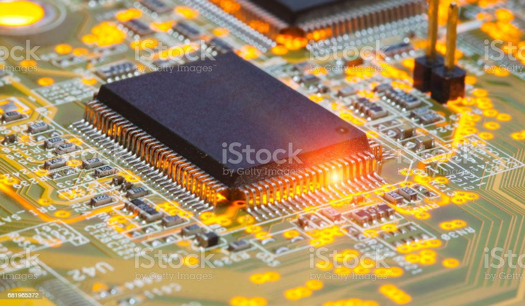 Electronic chip and standard inscriptions of resistors and condensers stock photo