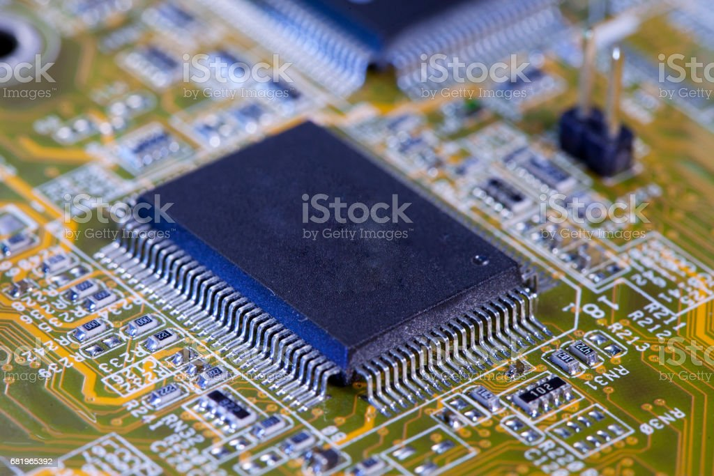 Electronic chip and standard inscriptions of resistors and condensers, small depth of sharpness stock photo