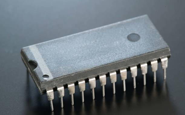 Electronic chip isolated on dark blue stock photo