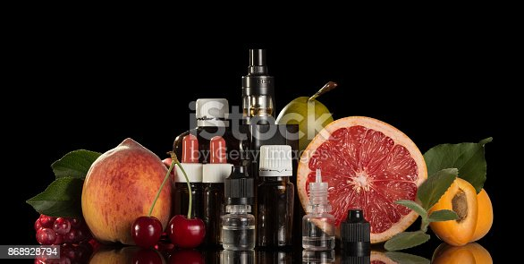 177005367 istock photo Electronic cigarette and set of different liquids for smoking isolated on black 868928794