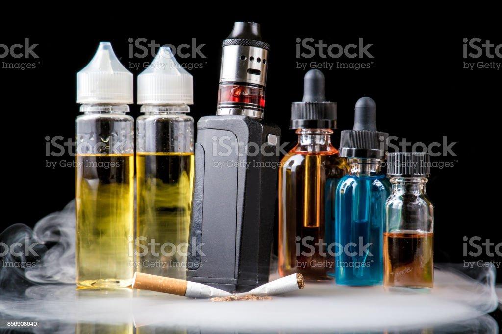 Electronic cigarette crushing tobacco cigarette under it stock photo