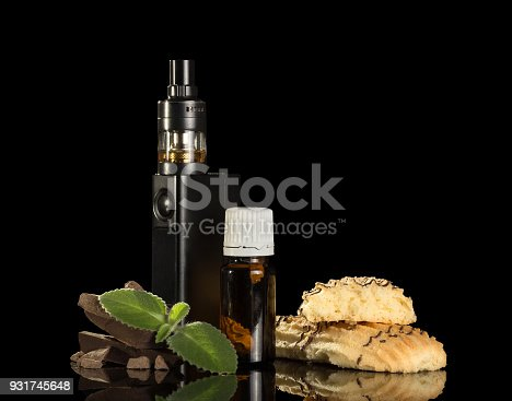 177005367 istock photo Electronic cigarette, flavored liquid, chocolate and biscuits, mint leaf, isolated on black 931745648