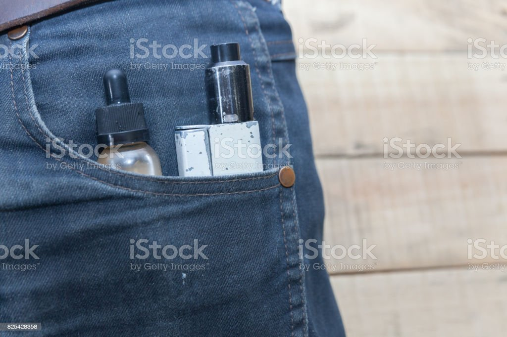 electronic cigarette in pocket stock photo