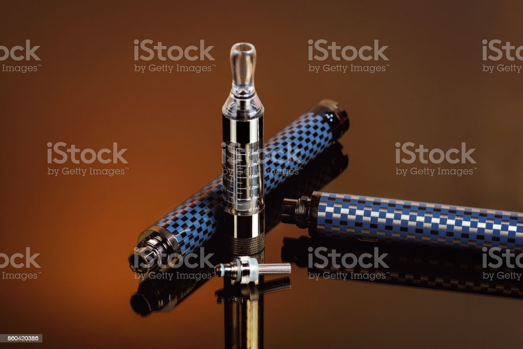 Electronic cigarette (vape) in the sorted look against a dark background. stock photo