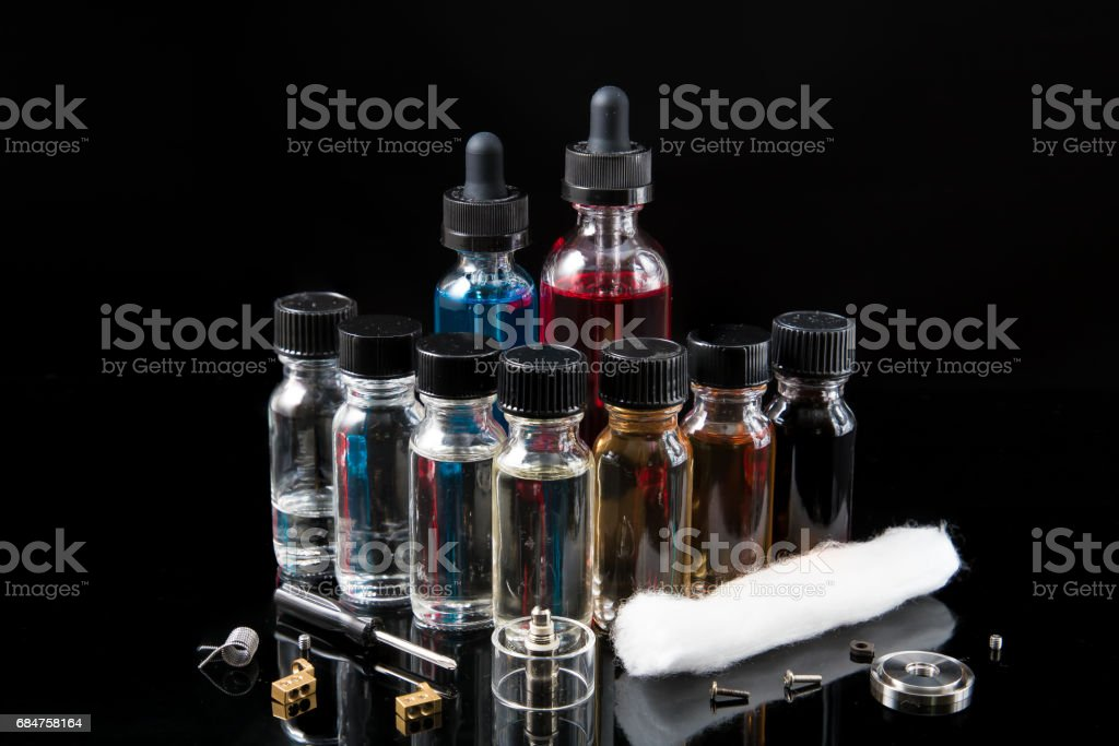 Electronic cigarette juices with DIY tools stock photo