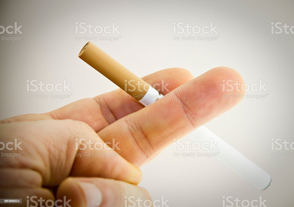 Electronic cigarette or cigarette? royalty-free stock photo