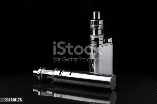 690146632 istock photo electronic cigarette or vaping device on black background 1005445176