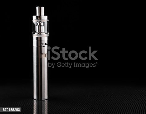 690146632 istock photo electronic cigarette or vaping device on black background 672188260