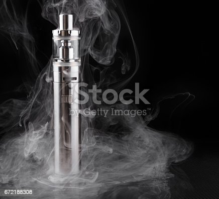 690146632 istock photo electronic cigarette or vaping device within vapor on black background 672188308