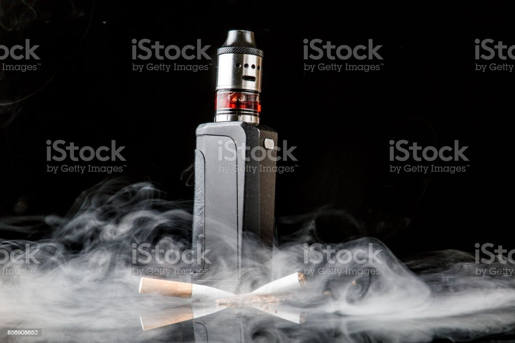 Electronic cigarette versus old tobacco cigarette stock photo