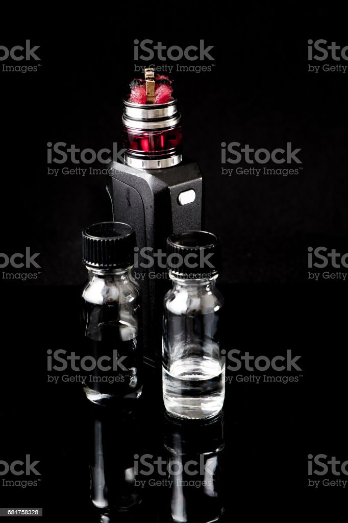 Electronic cigarette with 2 bottles stock photo