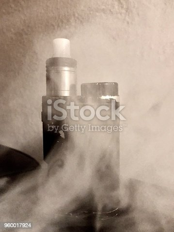 830035654 istock photo Electronic cigarette  with vapor 960017924
