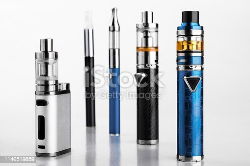 istock electronic cigarettes or vaping devices on white background 1146519859