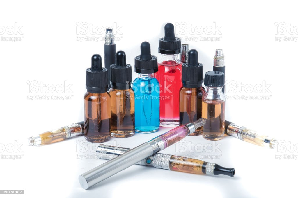 4 electronic cigarettes with glass e-liquid bottles and batteries on white background stock photo