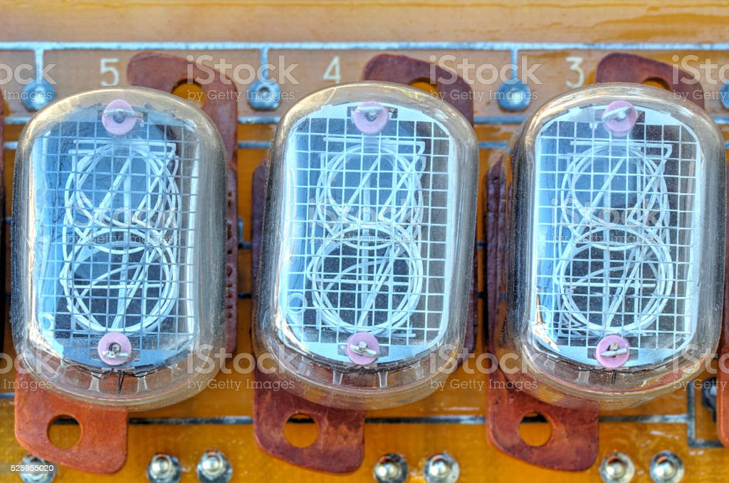 Electronic circuit board with old style indicator tubes stock photo