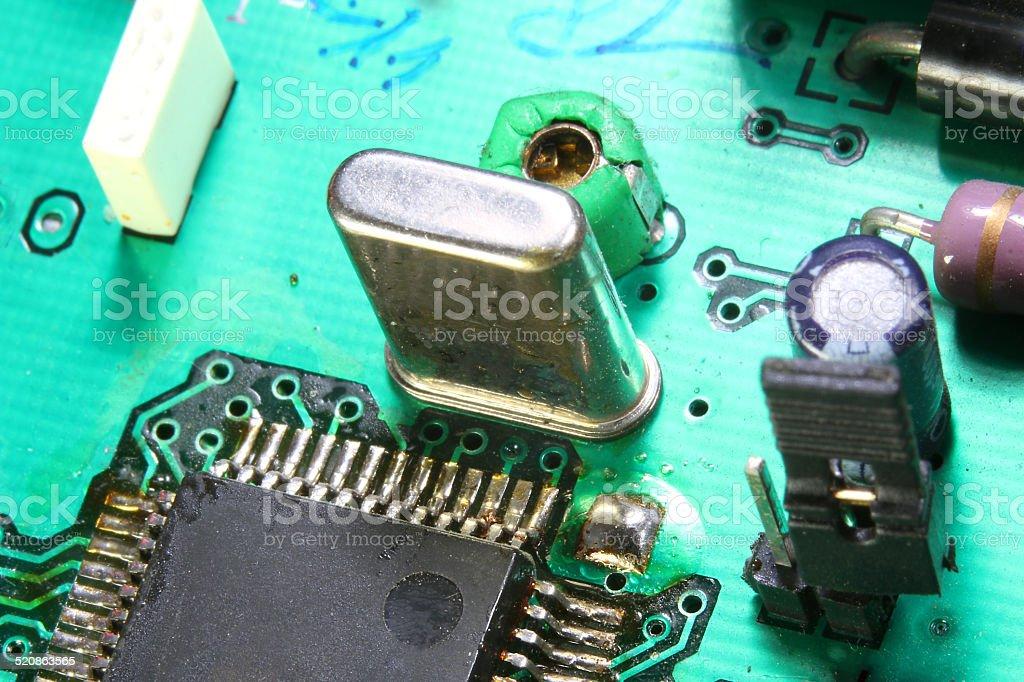 electronic circuit with microprocessor and quartz oscillator stock photo