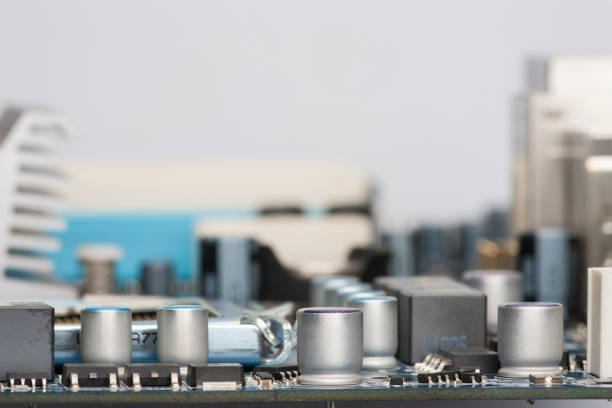 Electronic components are mounted on the device board Chips diodes capacitors chokes Close-up stock photo