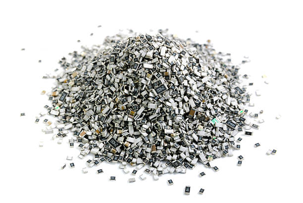 electronic components in bulk. texture of chip resistors - capacitor stock photos and pictures