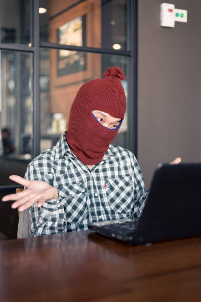 electronic crime concept. hacker is using computer. electronic crime concept. hacker is using computer. daunt stock pictures, royalty-free photos & images