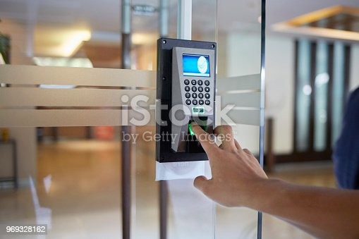 Yong man push down the electronic control machine to access the door