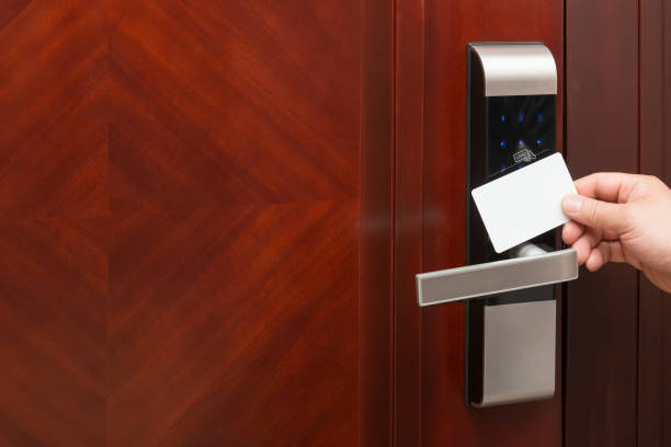 electronic door lock opening by an blank security card electronic door lock opening by an blank security card good for adding text and logo cardkey stock pictures, royalty-free photos & images