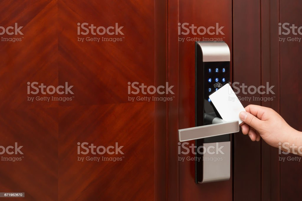 electronic door lock opening by an blank security card stock photo