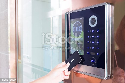 istock Electronic door lock opening by security card 826975020