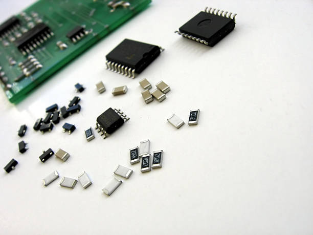 electronic elements - capacitor stock photos and pictures