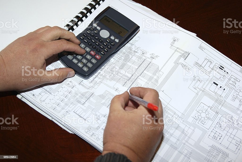 Electronic engineer or student working on an electrical drawing royalty-free stock photo