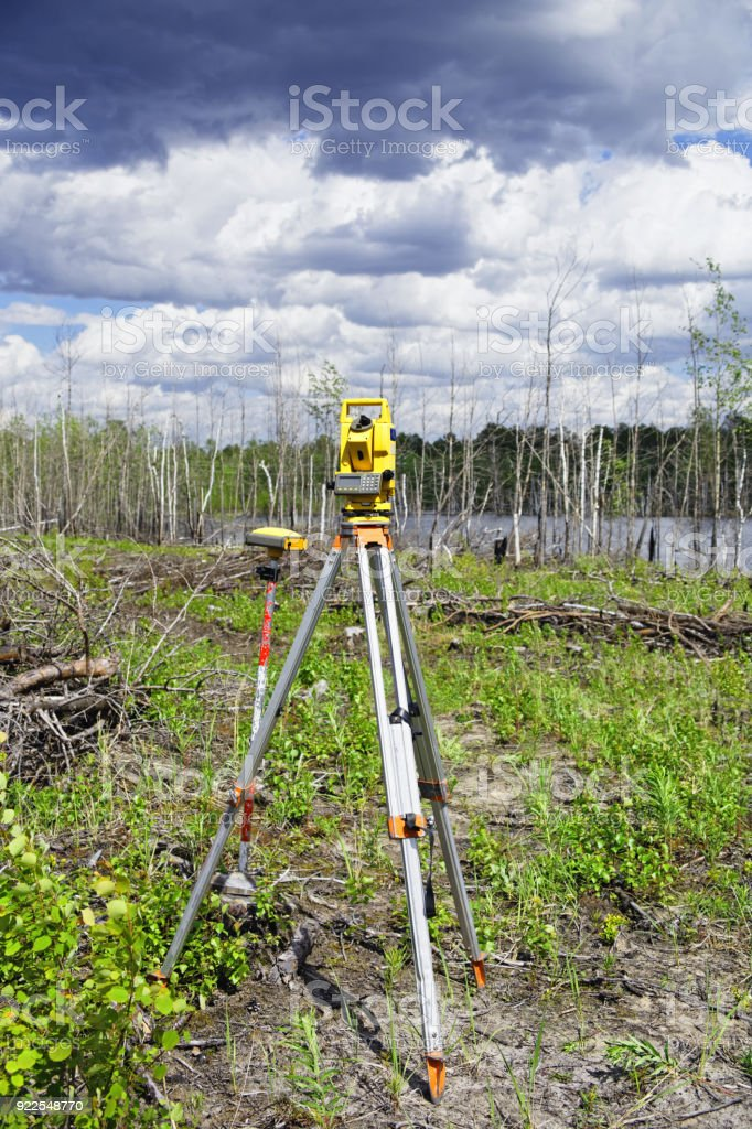 Electronic geodetic instruments in the field stock photo