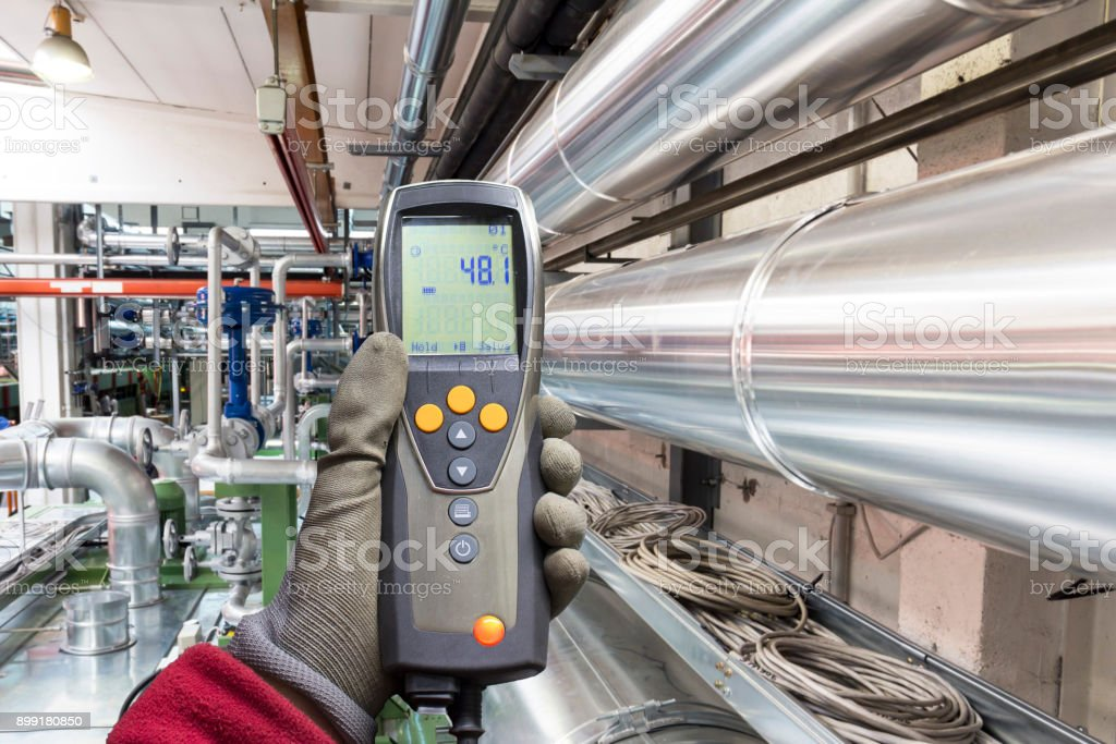 Electronic instrument for measuring temperature in a industry stock photo