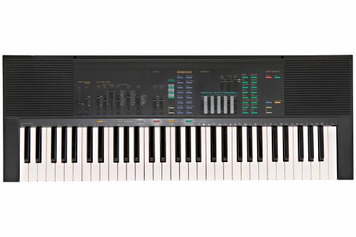Electronic keyboard against white background