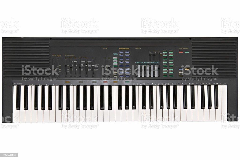 Electronic keyboard against white background stock photo
