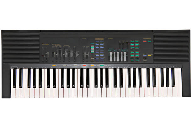 Electronic keyboard against white background Portable electronic keyboard from late eighties synthesizer stock pictures, royalty-free photos & images