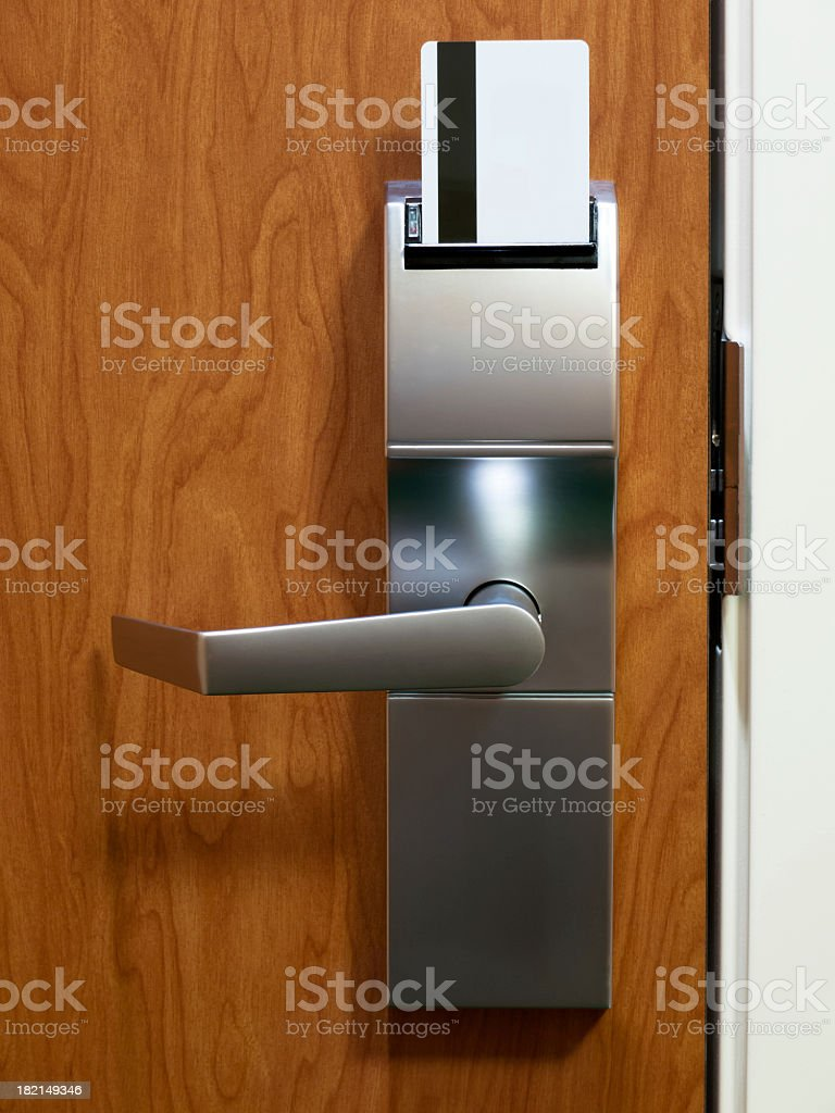 Electronic keycard in hotel door royalty-free stock photo