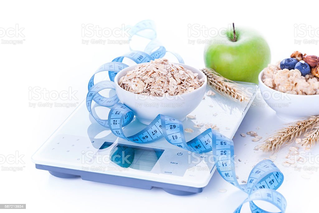 Electronic kitchen scale with healthy food stock photo