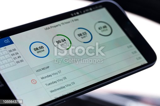 Electronic logging device for trucking industry with hours of service displayed on smartphone screen