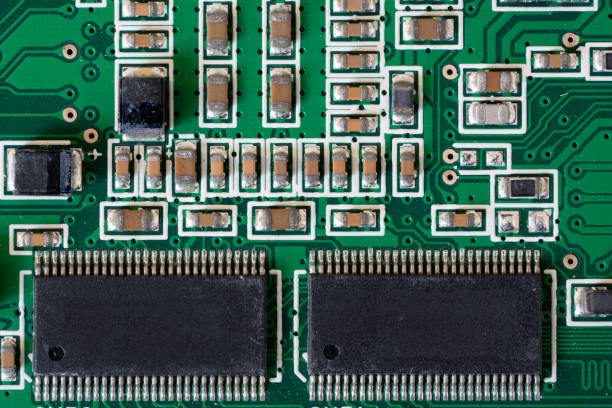 Electronic mainboard with chips, resistors, transistors, capacitors stock photo