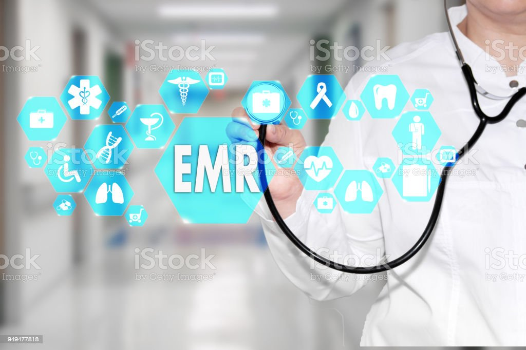Electronic medical records. EMR on the touch screen with medicine icons on the background blur Doctor in hospital. Innovation treatment, service, data analysis health. Medical Healthcare Concept Electronic medical records, EMR stock photo