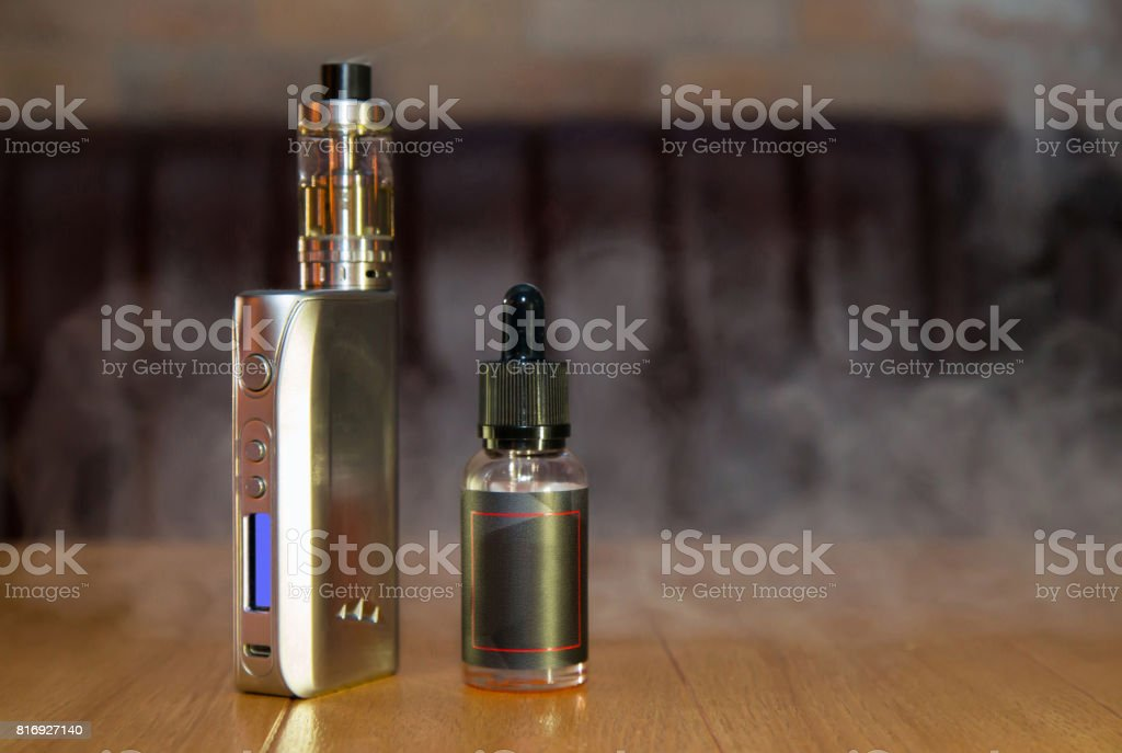 Electronic mod and vial stock photo