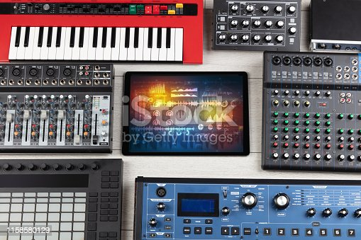 istock Electronic music instruments and tablet with reports concept 1158580129