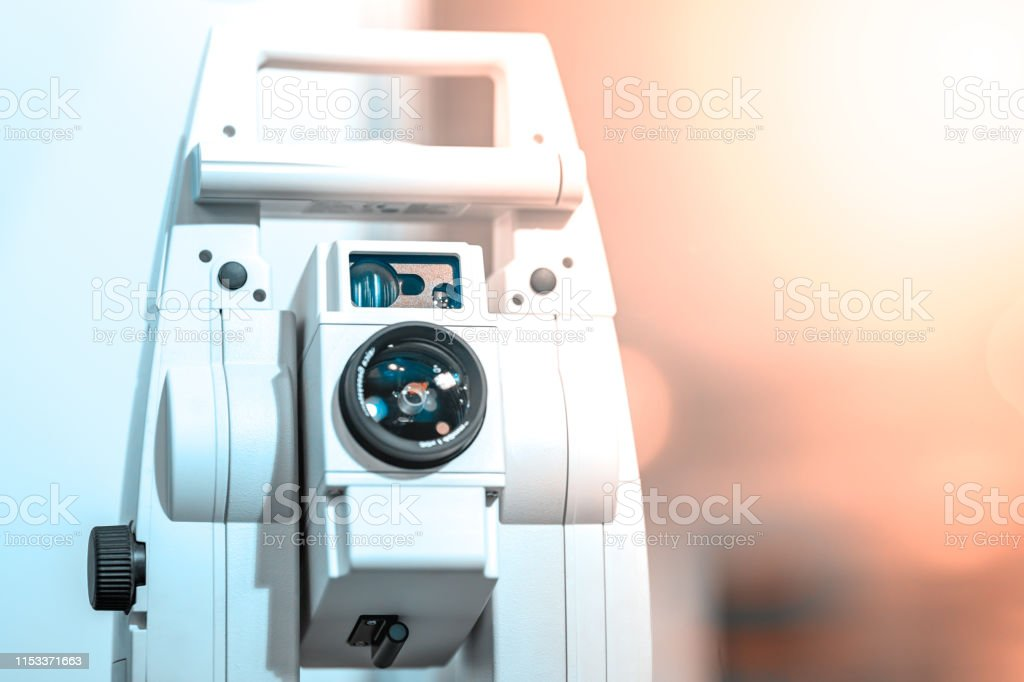 Electronic optical measuring device in white. Has the lens and...
