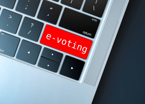 Electronic or internet voting concept (e-voting or online voting). Keyboard with red button with e-voting written on. stock photo