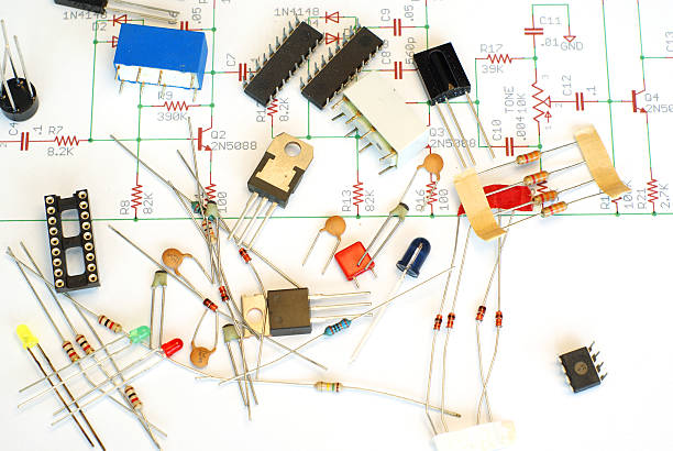 electronic parts on blueprint - capacitor stock photos and pictures