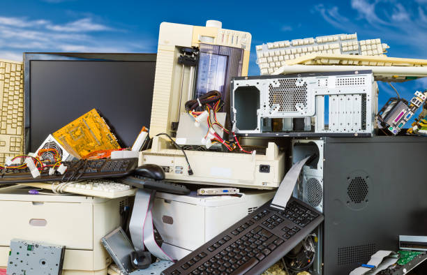 Electronic, plastic and metal waste on a dump of discarded computer components. Refuce sorting and disposal stock photo