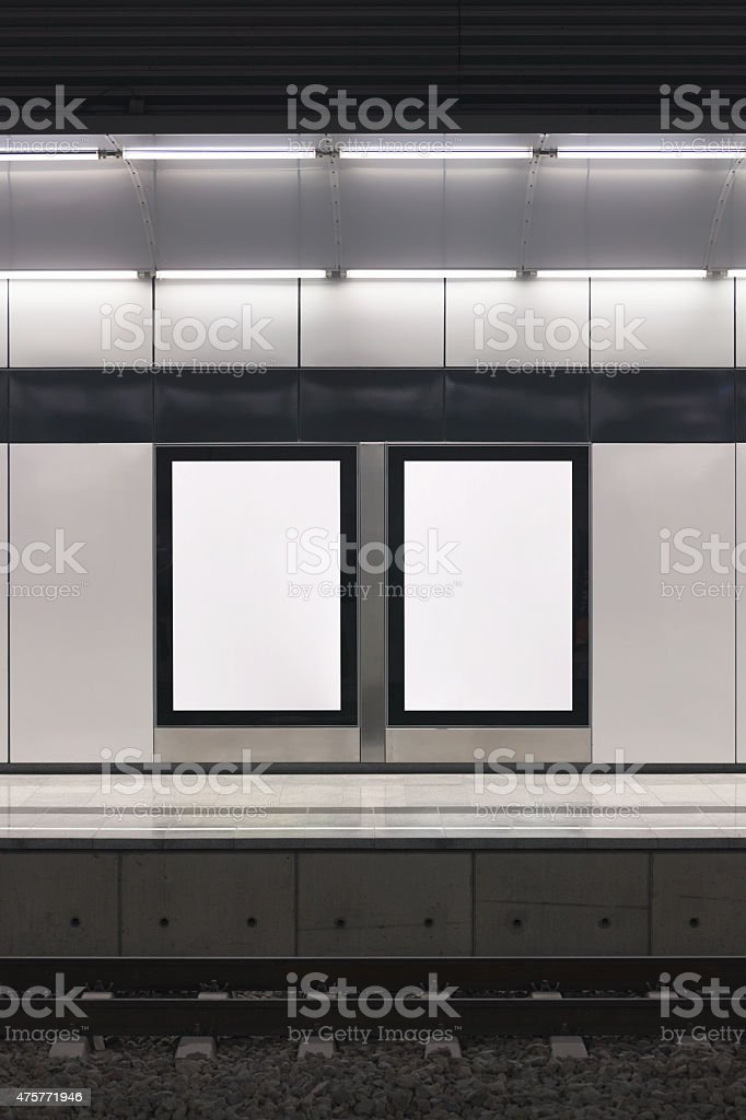Electronic posters at a station platform stock photo